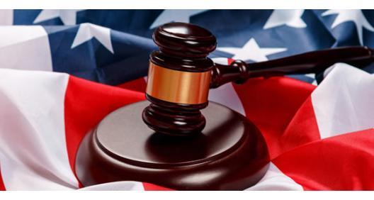 Michigan's top court hearing cases over guns, schools